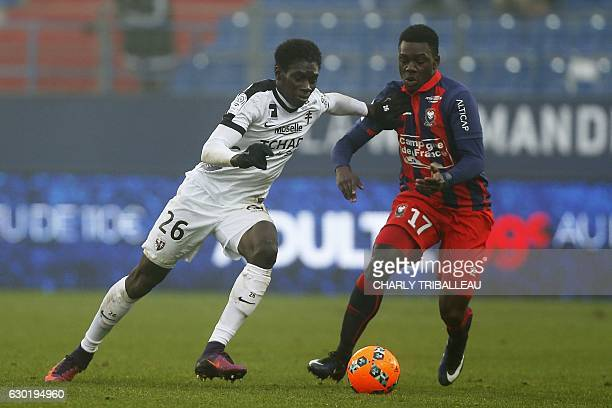 Metz's Senegalese midfielder Ismaila Sarr vies for the ball with Caen's Congolese midfielder JeanVictor Makengo during the French L1 football match...