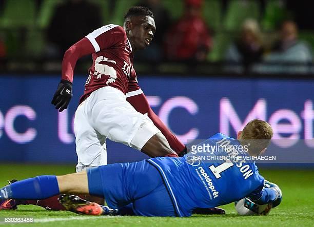 Metz's Senegalese midfielder Ismaila Sarr vies with Guingamp's Danish goalkeeper KarlJohan Johnsson during the French L1 football match between Metz...