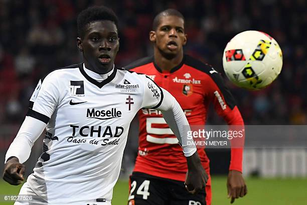 Metz's Senegalese midfielder Ismaila Sarr vies with Rennes' French defender Ludovic Baal during the French L1 football match Rennes against Metz on...