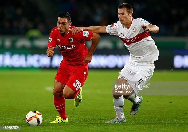 Mevluet Erdnic of Hannover battles for the ball with Toni Sunjic of Stuttgart during the Bundesliga match between Hannover 96 and VfB Stuttgart at...