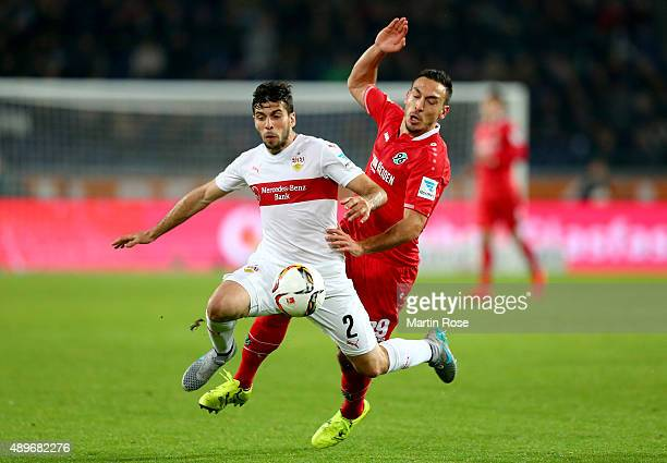 Mevluet Erdnic of Hannover battles for the ball with Zapata Insua of Stuttgart during the Bundesliga match between Hannover 96 and VfB Stuttgart at...
