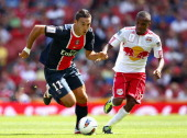 Mevlut Erdinc of Paris St Germain is closed down by Dane Richards of New York Red Bulls during the Emirates Cup match between New York Red Bulls and...