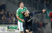 Mevlut Erding of SaintEtienne and Federico Bonazzoli of Inter Milan in action during the UEFA Europa League Group F match between AS SaintEtienne and...