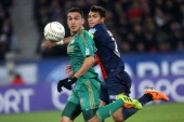 Mevlut Erding of SaintEtienne and Thiago Silva of PSG in action during the french Ligue Cup match between Paris SaintGermain FC and AS SaintEtienne...
