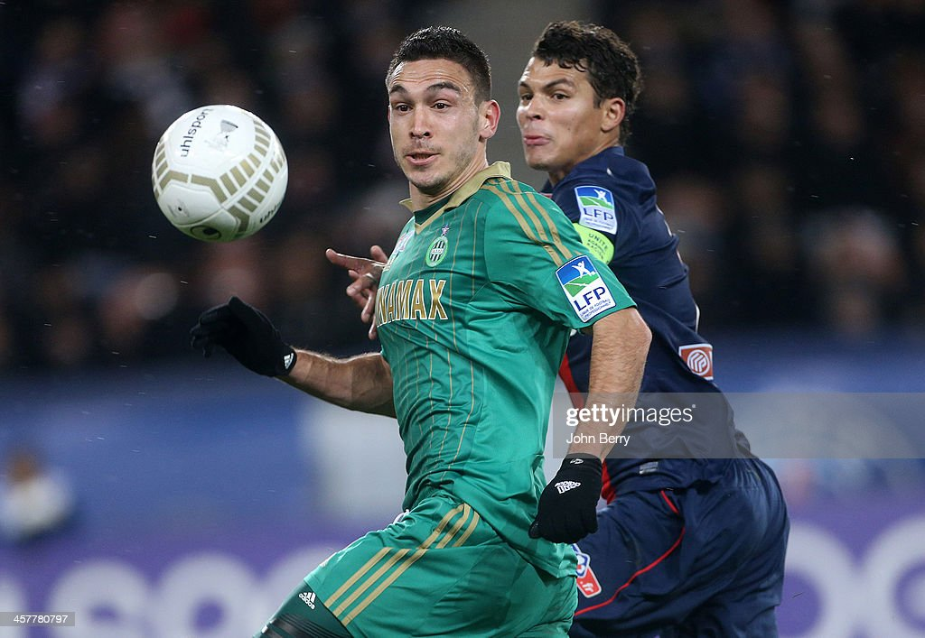 Mevlut Erding of Saint-Etienne and Thiago Silva of PSG in action during the french Ligue Cup match between Paris Saint-Germain FC and AS Saint-Etienne, ASSE, at the Parc des Princes stadium on December 18, 2013 in Paris, France.