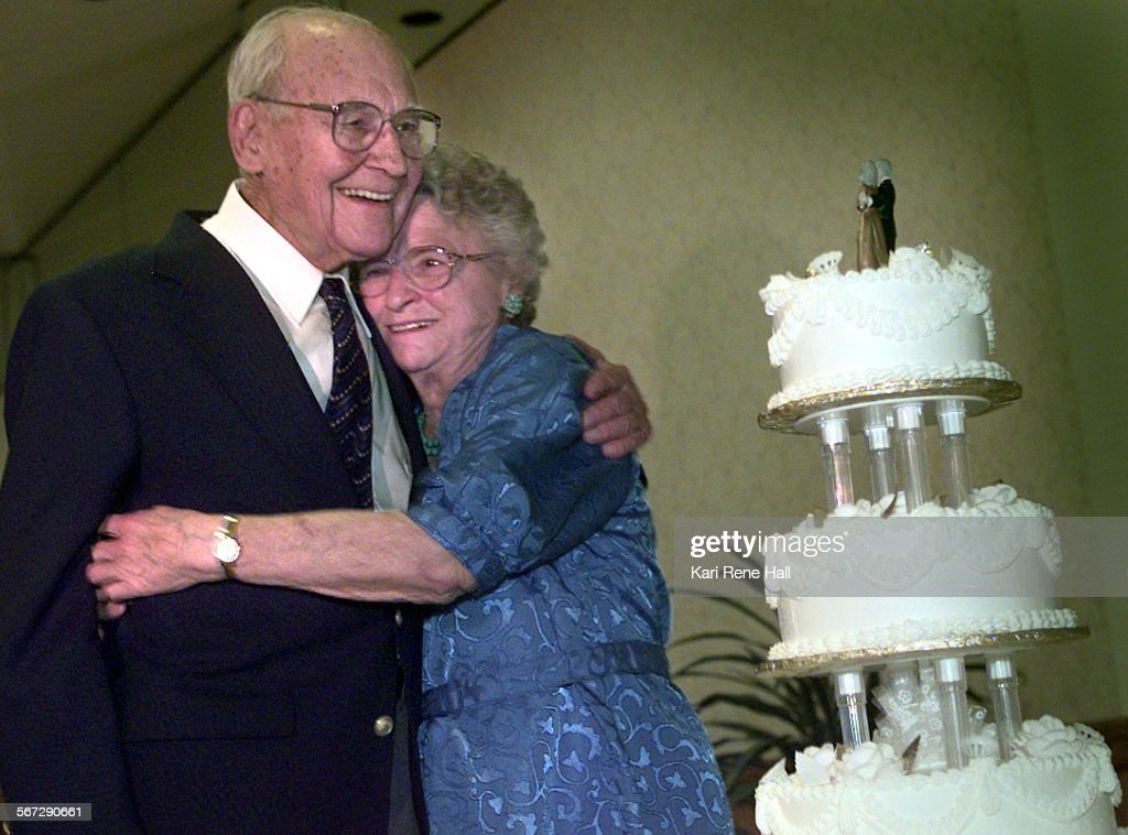 MEVowscakeD061898KRH––Harold and Ruth Gilbert both 88 of Huntington Beach get the honor of cutting the cake since they have been married 65 years the...