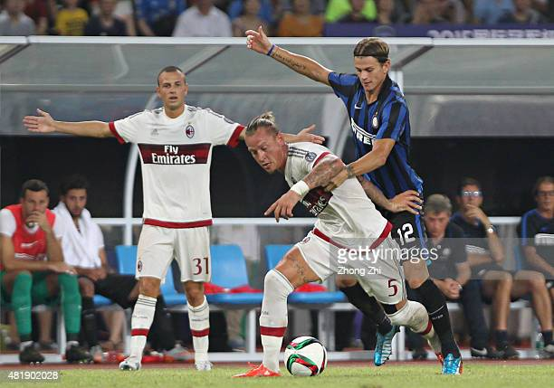 Mexes Philippe of AC Milan competes the ball with Longo Samuele of FC Internazionale during the match of International Champions Cup China 2015...