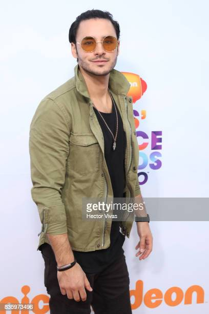 Mexican actor Enrique Montano poses for pictures during the Kids Choice Awards Mexico 2017 Orange Carpet at Auditorio Nacional on August 19 2017 in...