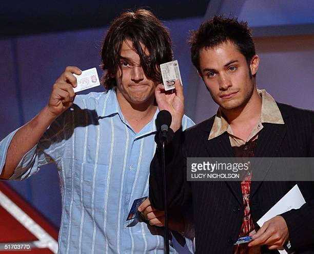 Mexican actors Diego Luna and Gael Garcia Bernal show off their US permanent resident green cards as they present at the 2002 ifp/west Independent...