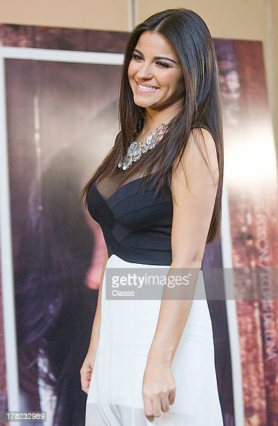 Mexican actress and singer Maite Perroni poses during a press conference for the presentation of her new album Eclipse de Luna on August 27 2013 in...