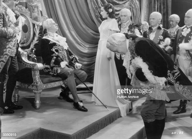 Mexican actress Dolores Del Rio as Madame Du Barry and Reginald Owen as Louis XV in a court scene from William Dieterle's remake of 'Madame DuBarry'