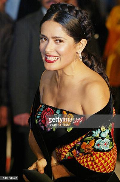 Mexican actress Salma Hayek arrives at the Palace Fine Arts for the opening of the movie 'Frida' 08 November 2002 in Mexico City Hayek stars as...