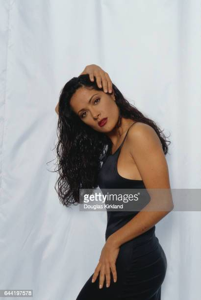 Mexican actress Salma Hayek poses with her hand on her head
