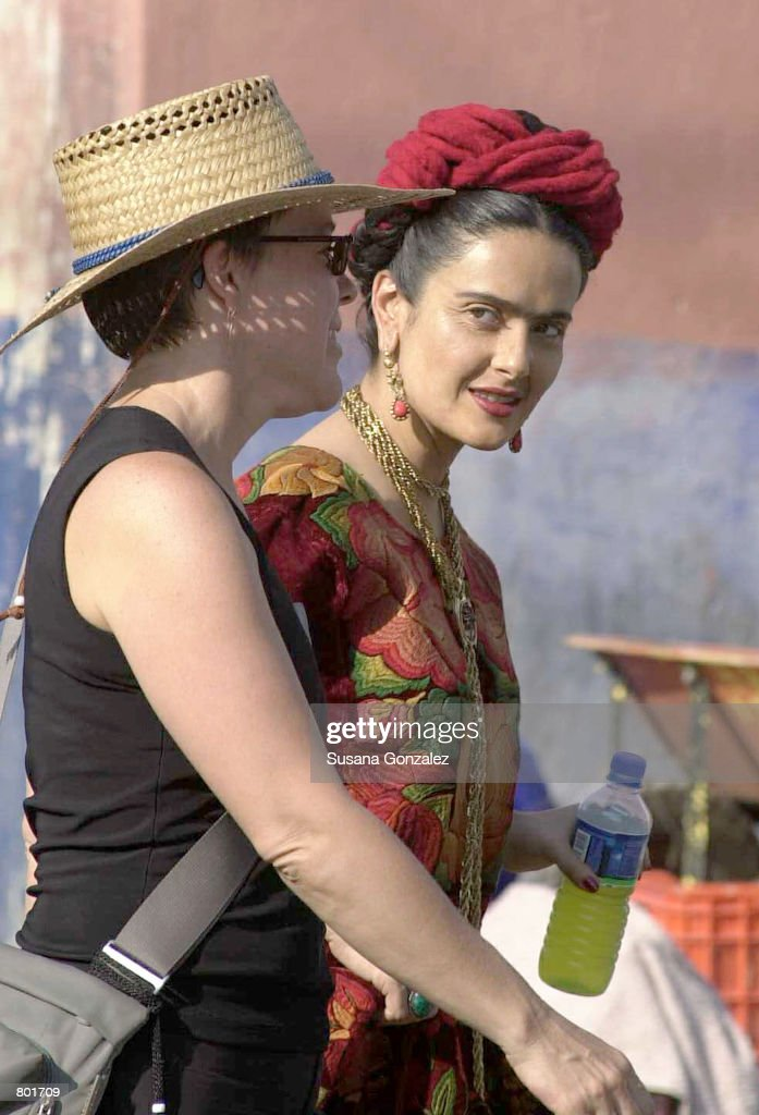 Mexican actress Salma Hayek, right, walks on the set of the film 'Frida Kahlo' with an unidentified woman April 12, 2001 in Puebla, Mexico. Hayek plays the title role in the movie currently being filmed on location in Mexico City, Paris and New York.