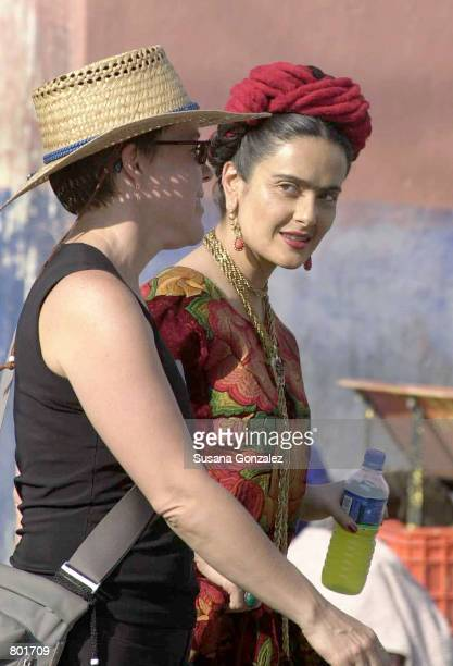 Mexican actress Salma Hayek right walks on the set of the film 'Frida Kahlo' with an unidentified woman April 12 2001 in Puebla Mexico Hayek plays...