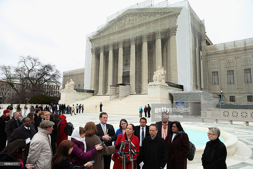 Mexican American Legal Defense and Education Fund Director of Litigation Nina Perales (6th R) and fellow litigants talk with reporters outside the U.S. Supreme Court after attending oral arguements in Arizona v. Inter Tribal Council et al. March 18, 2013 in Washington, DC. The court is hearing arguments about the constitutionality of an Arizona law requiring applicants to prove their citizenship before registering to vote under the federal National Voter Registration Act.