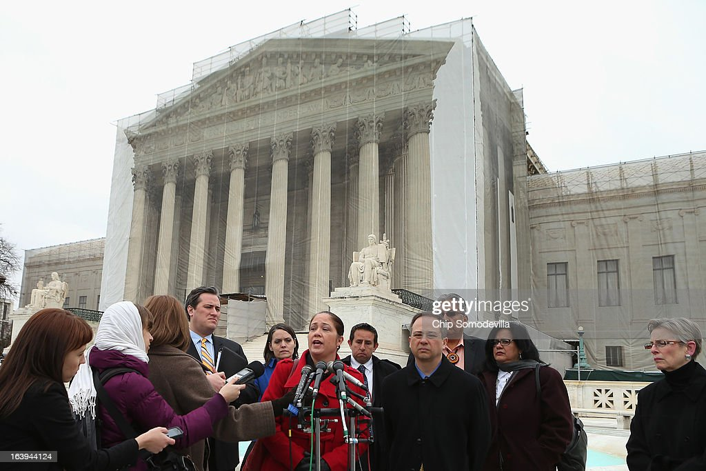 Mexican American Legal Defense and Education Fund Director of Litigation Nina Perales (C) and fellow litigants talk with reporters outside the U.S. Supreme Court after attending oral arguements in Arizona v. Inter Tribal Council et al. March 18, 2013 in Washington, DC. The court is hearing arguments about the constitutionality of an Arizona law requiring applicants to prove their citizenship before registering to vote under the federal National Voter Registration Act.