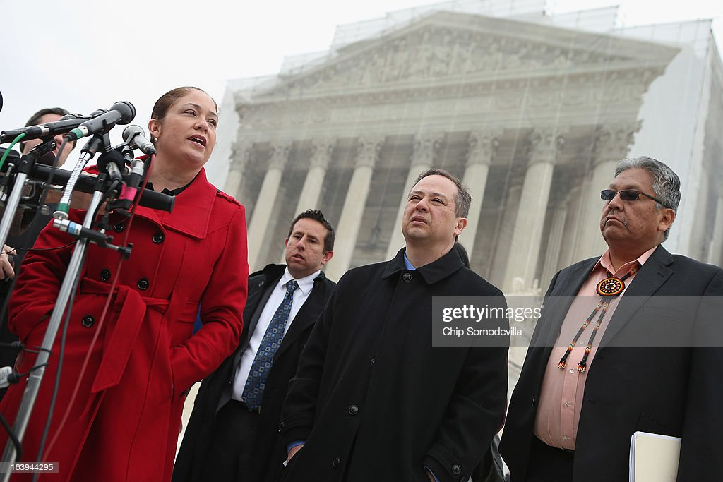 Mexican American Legal Defense and Education Fund Director of Litigation Nina Perales, MALDEF lawyer Luis Figaroa, Georgetown University law professor Jon Greenbaum and San Carlos Apache Tribal Chairman Terry Rambler talk with reporters outside the U.S. Supreme Court after attending oral arguements in Arizona v. Inter Tribal Council et al. March 18, 2013 in Washington, DC. The court is hearing arguments about the constitutionality of an Arizona law requiring applicants to prove their citizenship before registering to vote under the federal National Voter Registration Act.