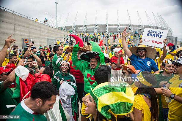 Mexican and Brazilian fans arrive at the stadium priot to the Group A match between Brazil and Mexico at Catelao Stadium as part of the FIFA World...