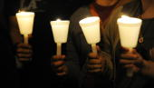 Mexican and Latino janitors hold a candlelight vigil calling for federal immigration reform in response to the tough new Arizona law giving the...