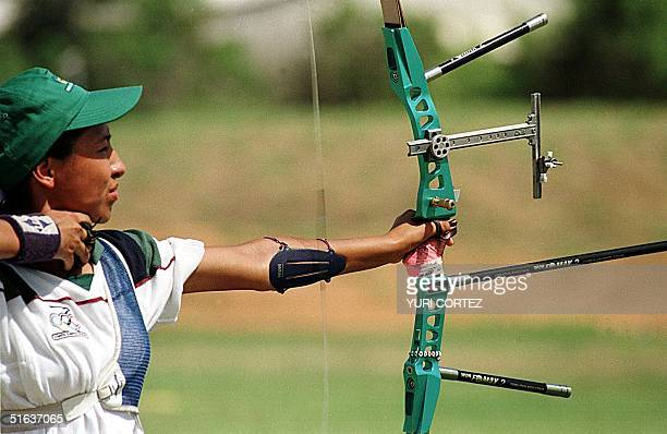 Mexican archer Marlen Saldana fires at the target during the 70meter archery finals 10 August in the Lake Complex in Maracaibo during the Central...