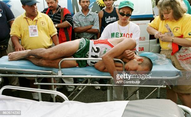 Mexican athlete Juan Camacho is put on a stretcher to recuperate 22 August after winning the gold medal in the marathon in Maracaibo Venezuela during...