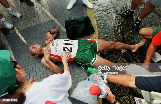 Mexican athlete Juan Camacho rests 22 August after winning the gold medal in the marathon in Maracaibo Venezuela during the Central American and...