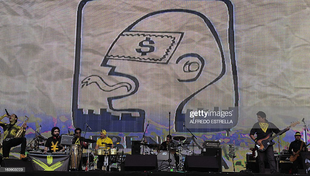 Mexican band Panteon Rococo performs during the third day of the Vive Latino 2013 Music Fest at the Foro Sol in Mexico City, on March 17, 2013. AFP PHOTO/Alfredo Estrella