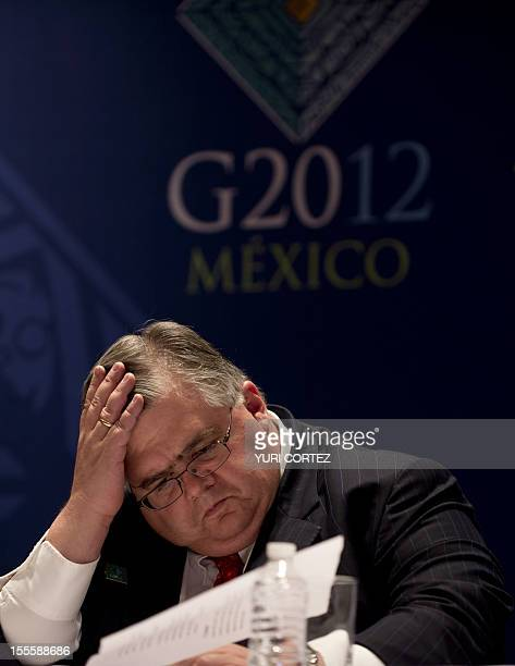 Mexican Bank Governor Agustin Carstens gestures during a joint press conference with Mexican Secretary of Finance and Public Credit Jose Antonio...