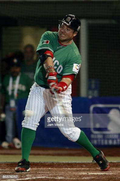 Mexican baseball player Karim Garcia hits the ball against South Africa during the World Baseball Classic 2009 on March 9 2009 in Mexico City Mexico