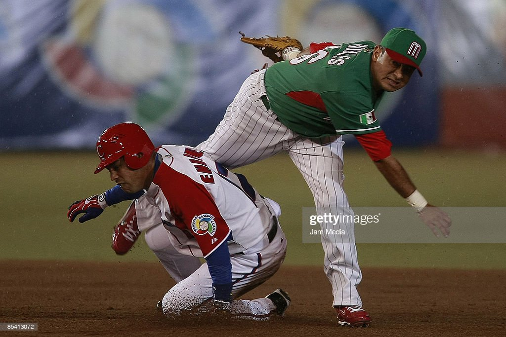 Mexican baseball player Oscar Robles and Michel Enriquez of Cuba during the World Baseball Classic 2009 on March 12 2009 in Mexico City Mexico