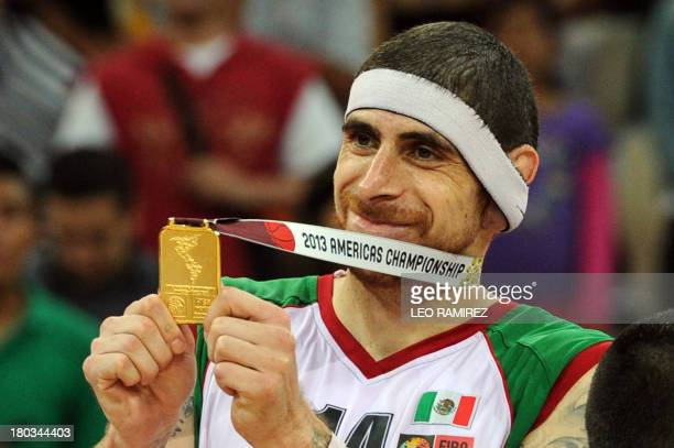 Mexican basketball team player Lorenzo Mata celebrates after defeating Puerto Rico and winning the FIBA Championship game held in Caracas on...