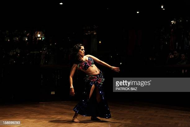 A Mexican belly dancer performs in the Egyptian capital Cairo on December 12 2012 This picture was taken during a belly dancing festival with...