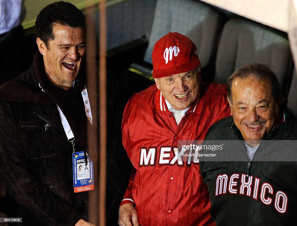 Mexican billionaire Carlos Slim (R) bishop Onesimo Zepeda (C) and mexican soccer great Carlos Hermosillo watch the game between Mexico and Cuba during the 2009 World Baseball Classic Pool B match on March 12, 2009 at the Estadio Foro Sol in Mexico City, Mexico. Cuba won, 16-4.