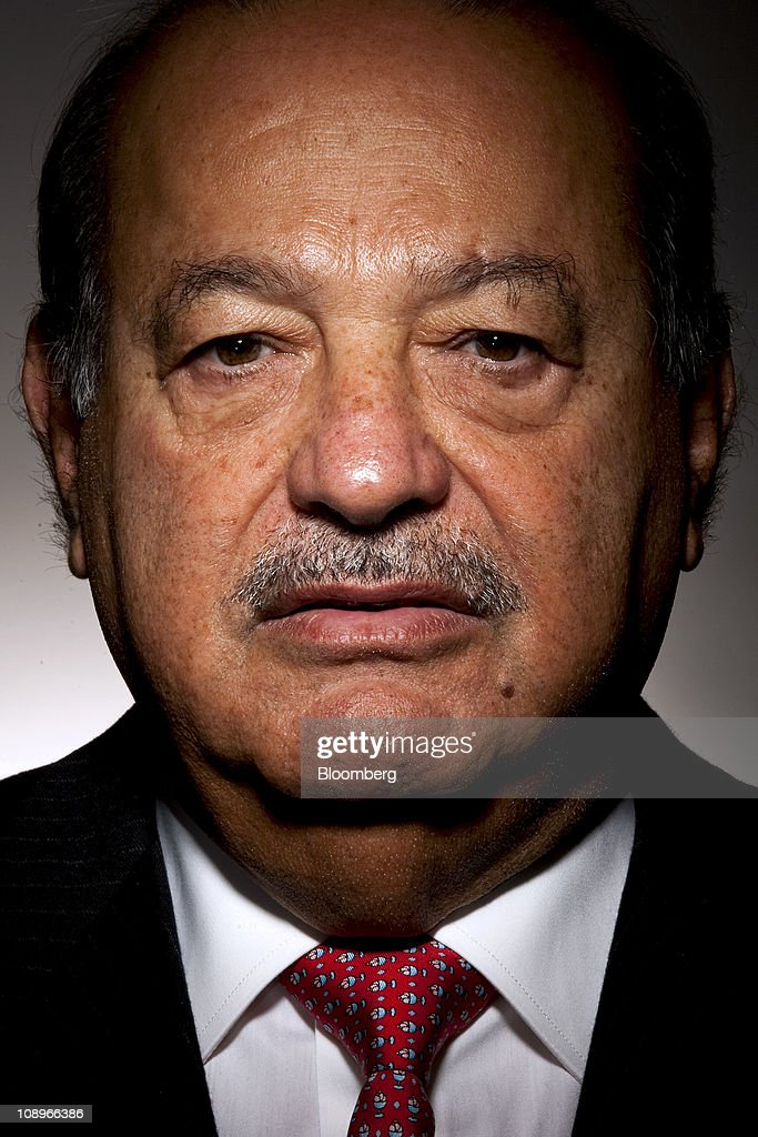 Mexican billionaire <a gi-track='captionPersonalityLinkClicked' href=/galleries/search?phrase=Carlos+Slim&family=editorial&specificpeople=584959 ng-click='$event.stopPropagation()'>Carlos Slim</a> stands for a photograph in New York, U.S., on Wednesday, Feb. 9, 2011. Slim, named the world's richest man by Forbes Magazine, said he's seeking to boost his investments in Colombia because of the country's open policy on oil exploration, its mineral assets and growing middle class. Photographer: Chris Goodney/Bloomberg via Getty Images