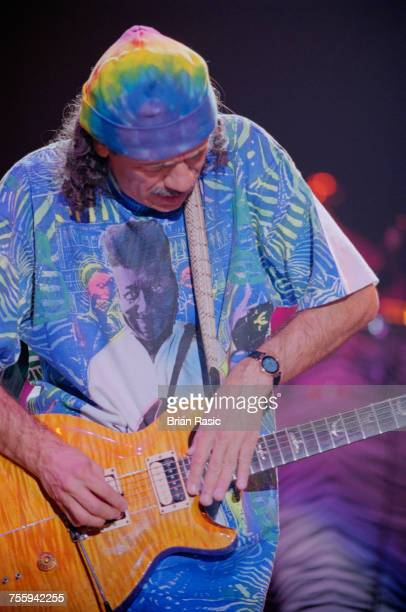 Mexican born American guitarist and musician Carlos Santana performs live on stage at the Hammersmith Apollo in London on 29th September 1994