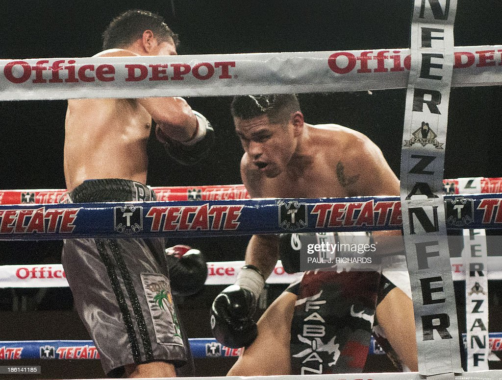 Mexican Boxer Francisco 'Frankie' Leal (R) and Raul Hirales Jr. during their fight on October 19, 2013 in Cabo San Lucas, Mexico. Leal, 26-yrs, was knocked out in the 8th round and taken away on a stretcher, died 3 days later from a cerebral contusion at a hospital in San Diego, California. Leal, whose nickname was 'The Little Soldier' had 29 wins, 8 lossses, and 3 draws. AFP Photo / Paul J. Richards