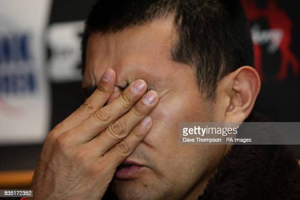 Mexican boxer Marco Antonio Barrera talks to the media during a press conference at Barburrito Mexican Grill Manchester