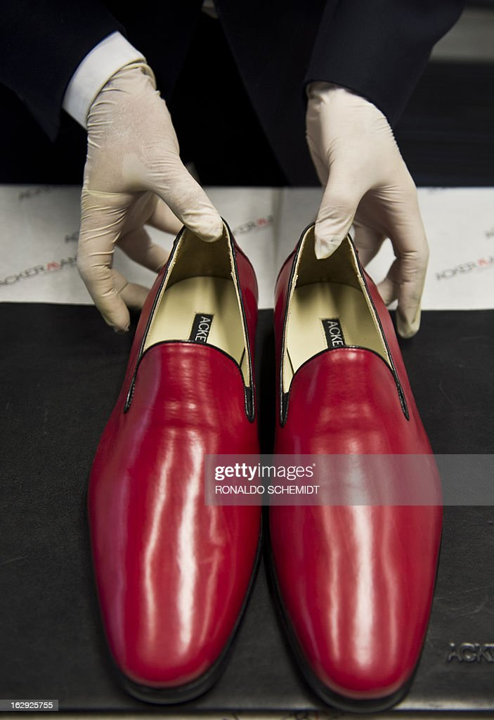 Mexican businessman Armando Martin displays shoes, the same model used by Pope Benedict XVI, in his factory in Leon, Guanajuato State, Mexico, on March 1, 2013. The shoes were a gift to the Pope during his last visit to Mexico in 2012. Benedict XVI became the first Pope to resign in over 700 years on Thursday, waving a last goodbye to a tearful crowd of faithful and telling them he would be 'a simple pilgrim' on life's last journey. AFP PHOTO/Ronaldo Schemidt