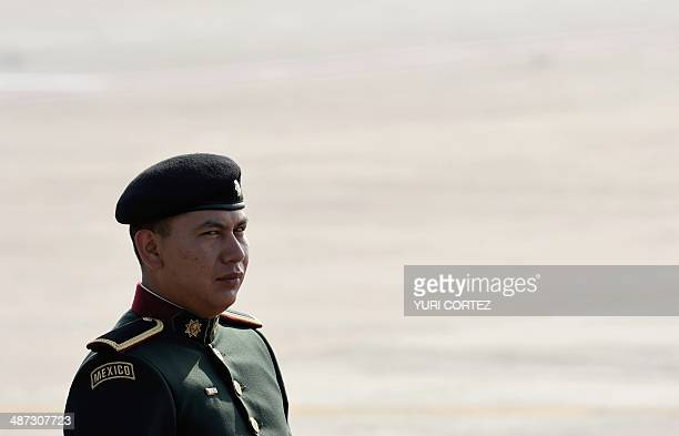A Mexican cadet waits on the tarmac for the arrival of Curazao's Prime Minister Ivar Asjes at the international airport of Merida Yucatan Mexico on...