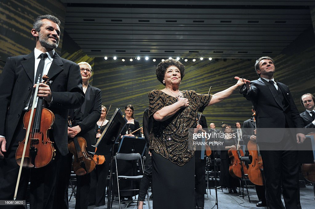 Mexican castanets player Lucero Tena (C) acknowledges the audience after a concert with the Lamoureux orchestra directed by French conductor Fayçal Karoui (R) on February 3, 2013, as part of the 'Folle Journee' music festival at the Cite des Congres in Nantes.