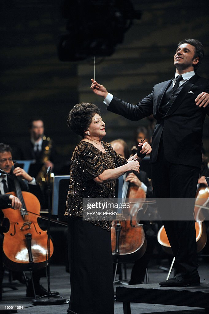 Mexican castanets player Lucero Tena (C) performs during a concert with the Lamoureux orchestra directed by French conductor Fayçal Karoui on February 3, 2013, as part of the 'Folle Journee' music festival at the Cite des Congres in Nantes. AFP PHOTO FRANK PERRY