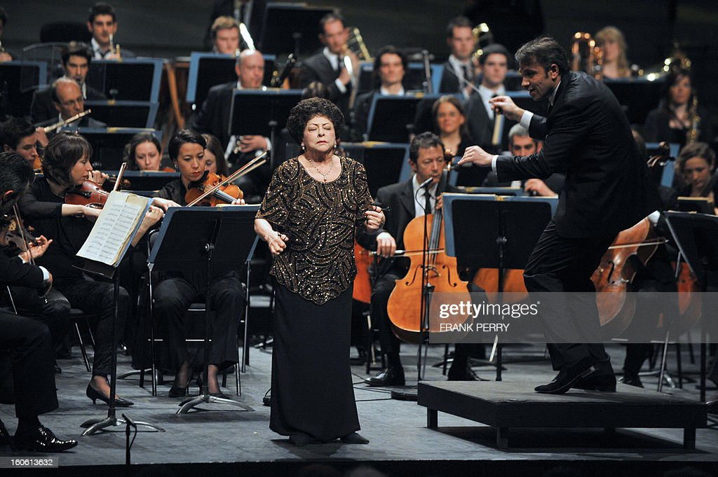Mexican castanets player Lucero Tena (C) performs during a concert with the Lamoureux orchestra directed by French conductor Fayçal Karoui on February 3, 2013, as part of the 'Folle Journee' music festival at the Cite des Congres in Nantes.