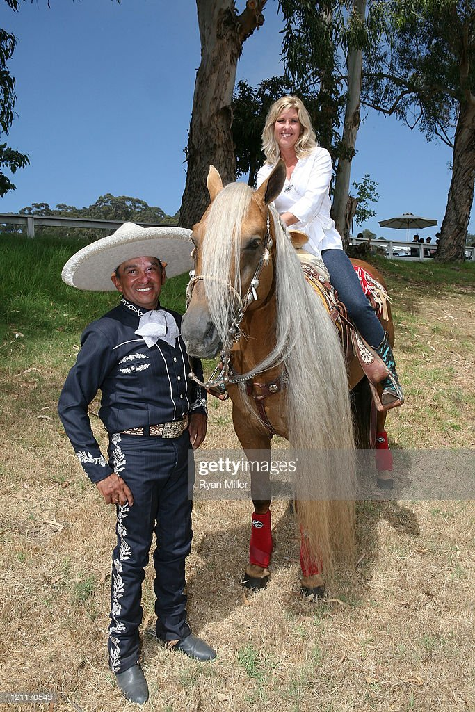 Mexican Charro and Rope Artist Tomas Garcilazo and Jennifer RogersEtcheverry pose during the Will Rogers Ranch Foundation's Dog Iron Polo Match...
