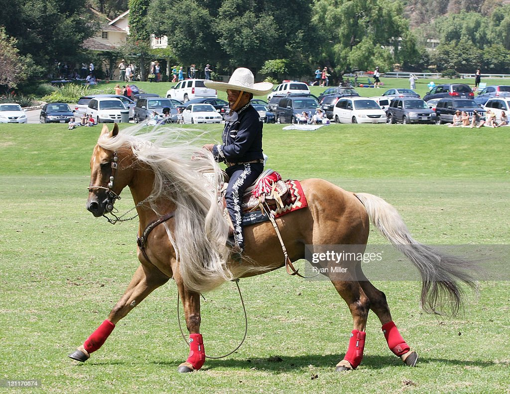 Mexican Charro and Rope Artist Tomas Garcilazo performs during the Will Rogers Ranch Foundation's Dog Iron Polo Match Champagne Brunch on August 14...