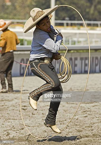 A Mexican Charro performs at the Racetrack of the Americas during the celebration of the National Charreada February 3 2008 in Mexico City The...