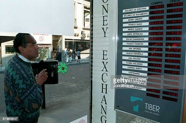 Mexican checks the international exchange rate for the Mexican Peso at a local bank 09 January in Mexico City The US Federal Reserve intervened twice...