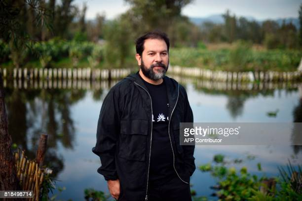 Mexican chef Enrique Olvera poses for pictures during a symposium on biodiversity and gastronomy amid the floating gardens of Xochimilco a UNESCO...
