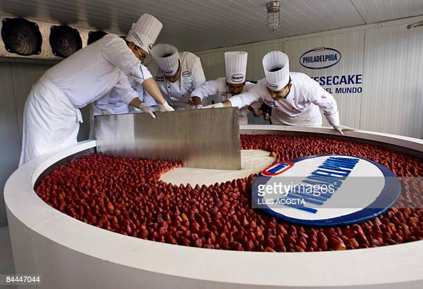 Mexican chefs cut a huge cheesecake which attempts to set a Guinness World Record in Mexico City on January 25 2009 The biggest cheesecake of the...