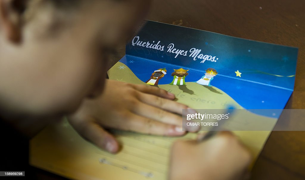 A Mexican child writes a letter to the Three Kings at the main post office in Mexico City on January 4, 2013. In Spanish-speaking parts of the world, children believe that the Three Kings receive their letters and so bring them gifts on the night before Epiphany. The Mexican Post Office opened this service to encourage the use of traditional mail.